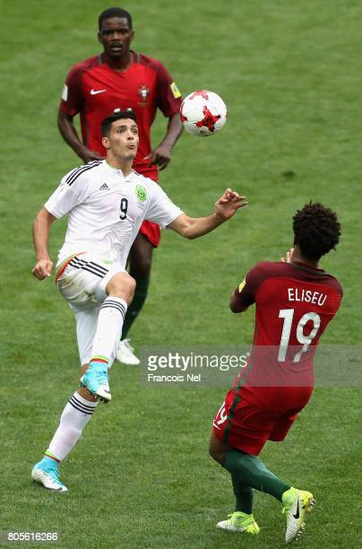 Raul Jimenez of Mexico and Eliseu of Portugal battle to win a header during the FIFA Confederations Cup Russia 2017 PlayOff for Third Place between...