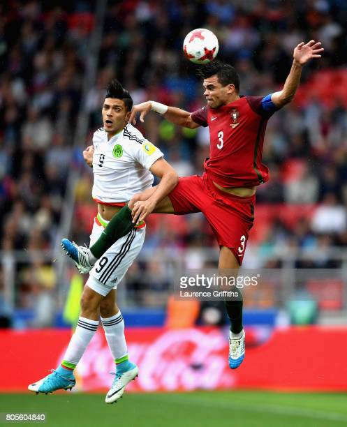 Raul Jimenez of Mexico and Pepe of Portugal battle to win a header during the FIFA Confederations Cup Russia 2017 PlayOff for Third Place between...