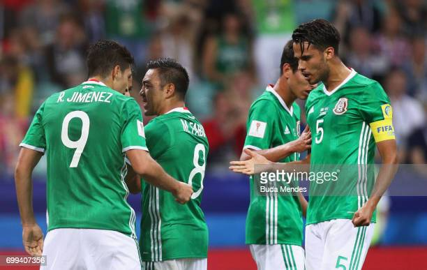 Raul Jimenez of Mexico celebrates scoring his sides first goal with Diego Reyes of Mexico during the FIFA Confederations Cup Russia 2017 Group A...