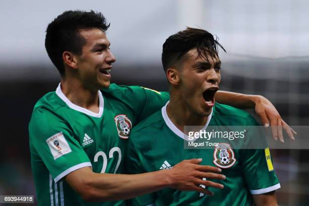 Raul JimŽenez of Mexico celebrates with teammate Hirving Lozano after scoring his team's third goal during the match between Mexico and Honduras as...