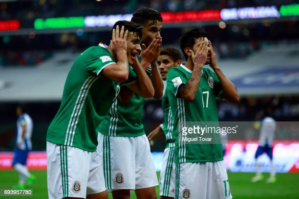 Raul JimeŽnez of Mexico celebrates with teammates after scoring his team's third goal during the match between Mexico and Honduras as part of the...