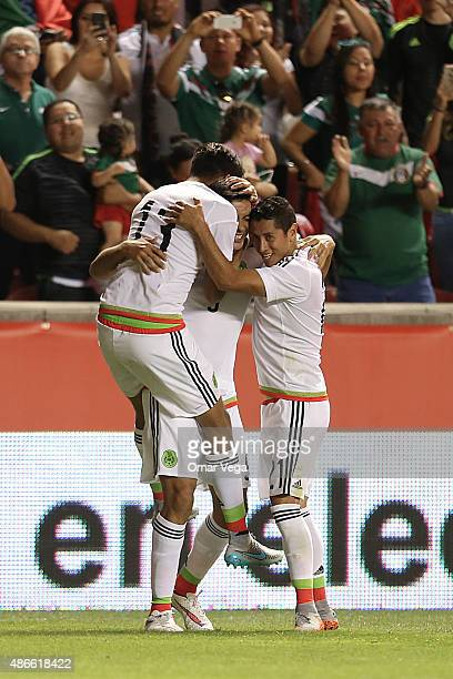 Raul Jimenez of Mexico celebrates with teammates after scoring the second goal of his team during a friendly match between Mexico and Trinidad and...
