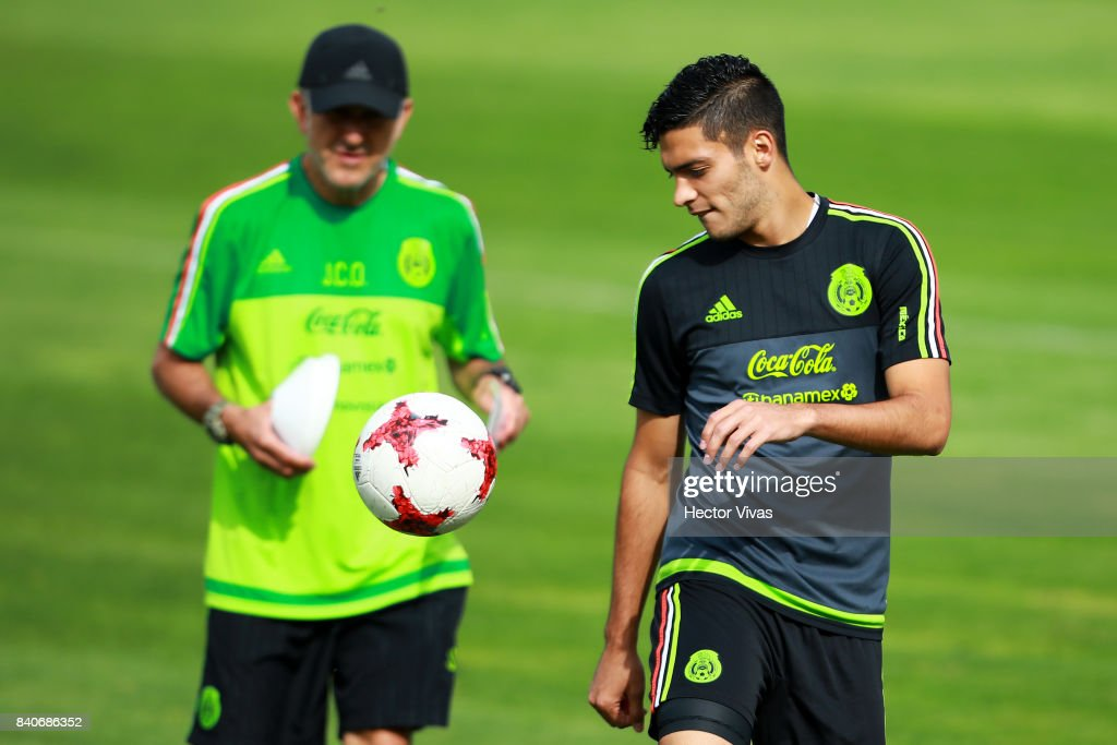 Raul Jimenez of Mexico controls the ball as his coach Juan Carlos Osorio looks on during a training session at Centenario Stadium on August 28, 2017 in Cuernavaca, Mexico.