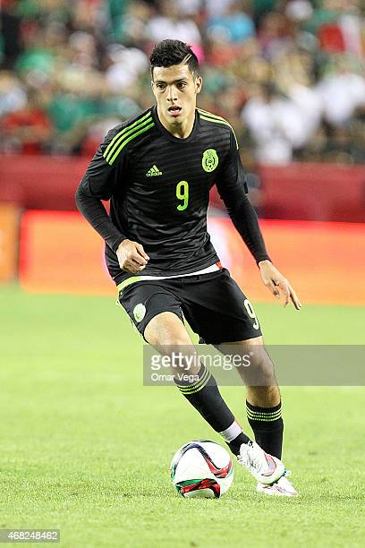Raul Jimenez of Mexico drives the ball during an international friendly match between Paraguay and Mexico at Arrowhead Stadium on March 31 2015 in...