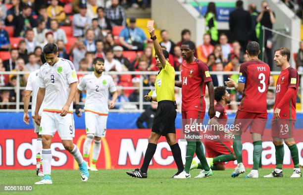Raul Jimenez of Mexico is shown a red card by Referee Fahad Al Mirdasi during the FIFA Confederations Cup Russia 2017 PlayOff for Third Place between...