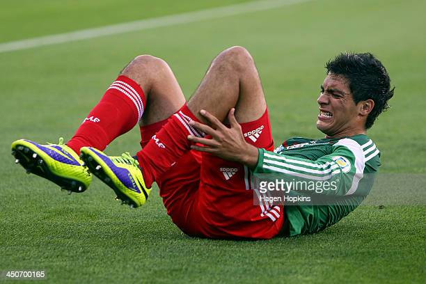 Raul Jimenez of Mexico reacts after a heavy challenge during leg 2 of the FIFA World Cup Qualifier match between the New Zealand All Whites and...