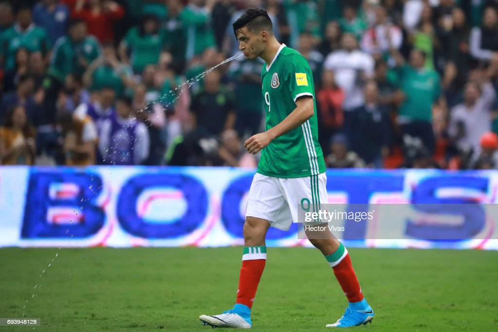 Raul Jimenez of Mexico spits water after scoring the third goal of his team during the match between Mexico and Honduras as part of the FIFA 2018 World Cup Qualifiers at Azteca Stadium on June 08, 2017 in Mexico City, Mexico.