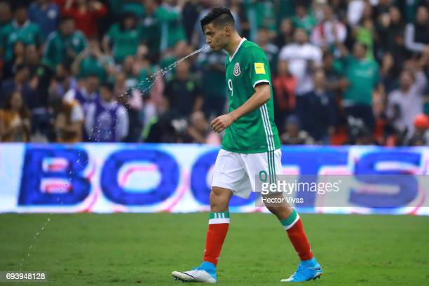Raul Jimenez of Mexico spits water after scoring the third goal of his team during the match between Mexico and Honduras as part of the FIFA 2018...