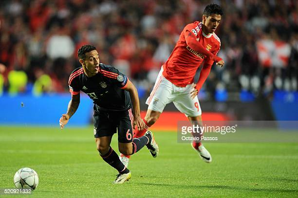 Raul Jimenez of SL Benfica challenges Thiago Alcantara of FC Bayern Muenchen during the UEFA Champions league Quarter Final Second Leg match between...
