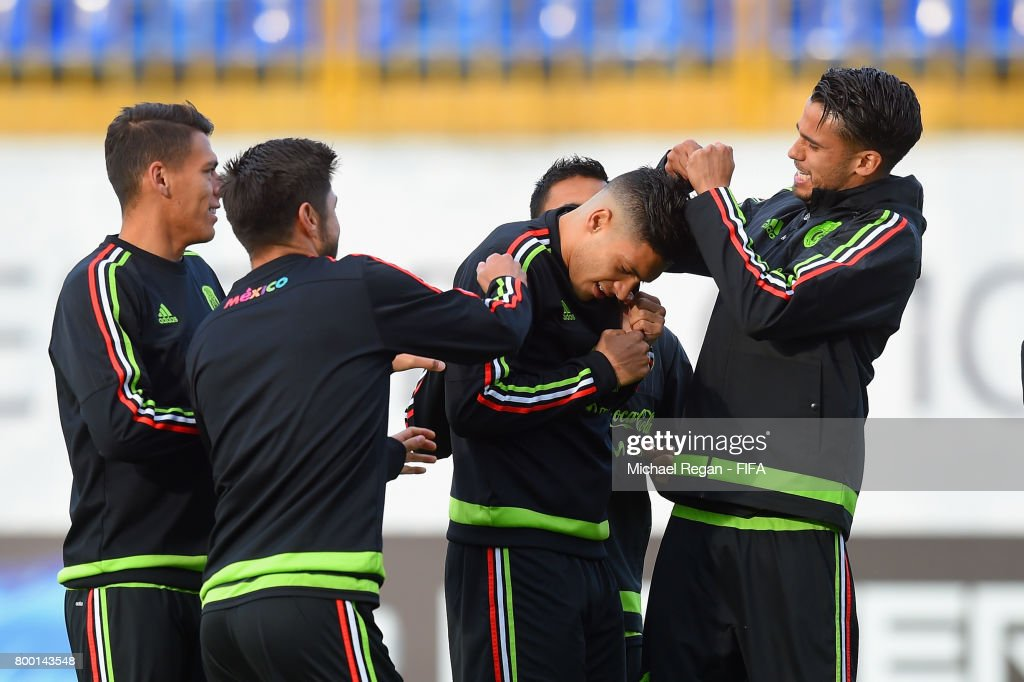 Raul Jimenez receives a forfeit from Diego Reyes during the Mexico training session on June 23, 2017 in Kazan, Russia.