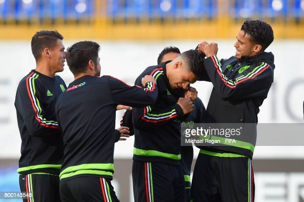 Raul Jimenez receives a forfeit from Diego Reyes during the Mexico training session on June 23 2017 in Kazan Russia