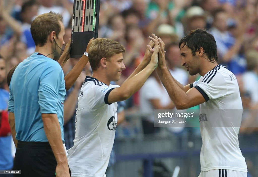 Raul (R) leaves the pitch when Max Meyer gets in during his farewell match between Schalke 04 and Al-Sadd Sports Club Katar at Veltins Arena on July 27, 2013 in Gelsenkirchen, Germany.