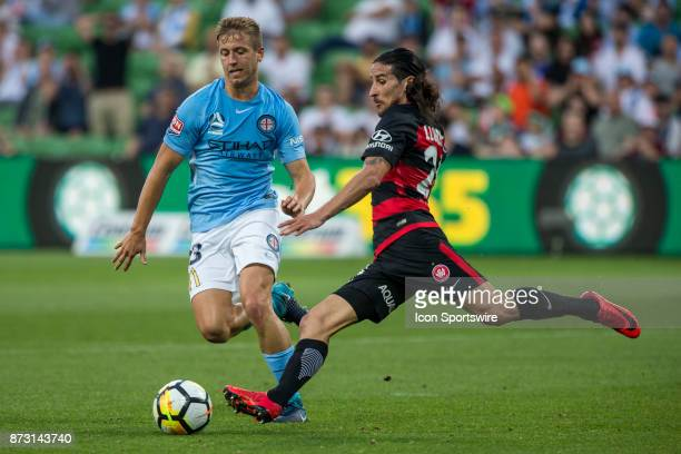 Raul Llorente of the Western Sydney Wanderers prepares to kick the ball in front of Stefan Mauk of Melbourne City during Round 6 of the Hyundai...