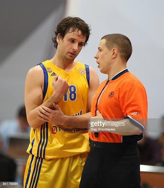 Raul Lopez #18 of BC Khimki competes with referee Olegs Latisevs in action during the Euroleague Basketball Regular Season 20092010 Game Day 7...