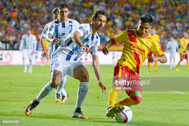 Raul Lopez of Pachuca and Raul Ruidiaz of Morelia fight for the ball during the fifth round match between Morelia and Pachuca as part of the Torneo...