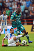 Raul Lopez of Pachuca vies for the ball with Hernan Burbano of Leon during their Mexican Apertura 2016 Tournament football match at the Hidalgo...