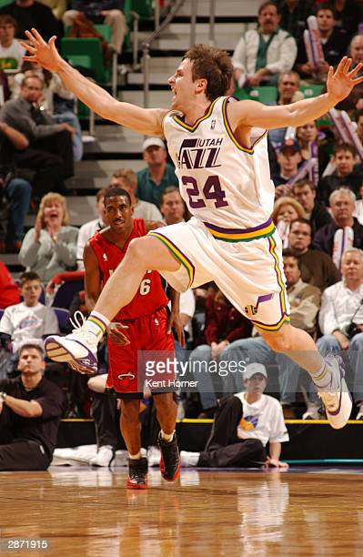 Raul Lopez of the Utah Jazz leaps for a loose ball against the Miami Heat on January 15 2004 at the Delta Center in Salt Lake City Utah They Jazz...