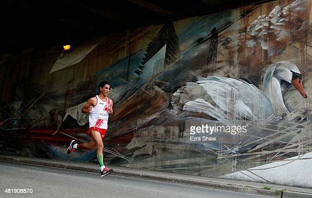 Raul Machacuay of Peru runs past a mural during the men's marathon on Day 15 of the Toronto 2015 Pan Am Games on July 25 2015 in Toronto Canada