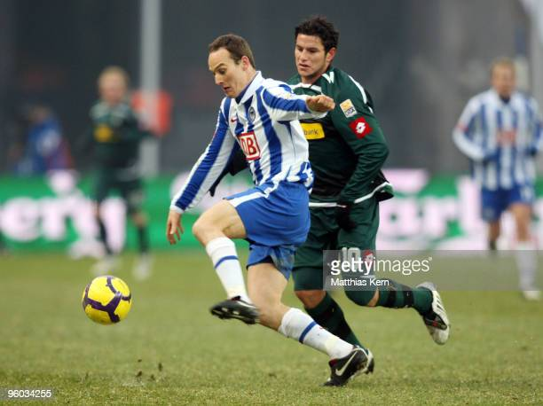 Raul Marcelo Bobadilla of Moenchengladbach battles for the ball with Steve von Bergen of Berlin during the Bundesliga match between Hertha BSC Berlin...