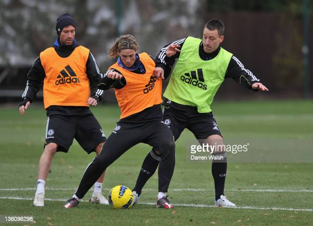 Raul Meireles Fernando Torres John Terry of Chelsea during a training session at the Cobham training ground on December 24 2011 in Cobham England