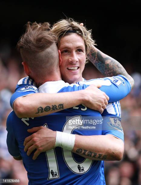 Raul Meireles of Chelsea congratulates team mate Fernando Torres on scoring his second goal during the FA Cup sixth round match between Chelsea and...