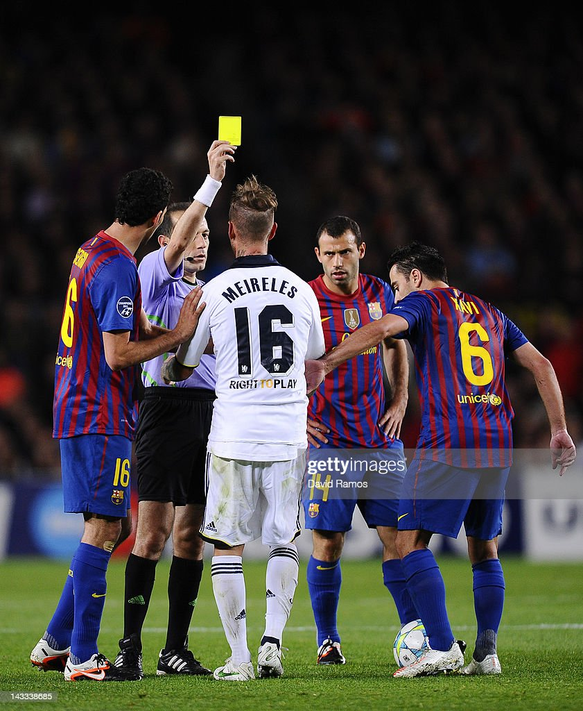 Raul Meireles of Chelsea FC is shown a yellow card by referee Cuneyt Cakir during the UEFA Champions League Semi Final, second leg match between FC Barcelona and Chelsea FC at Camp Nou on April 24, 2012 in Barcelona, Spain.