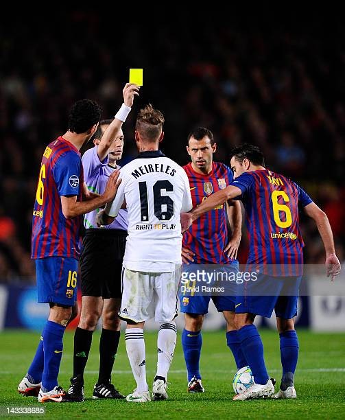 Raul Meireles of Chelsea FC is shown a yellow card by referee Cuneyt Cakir during the UEFA Champions League Semi Final second leg match between FC...