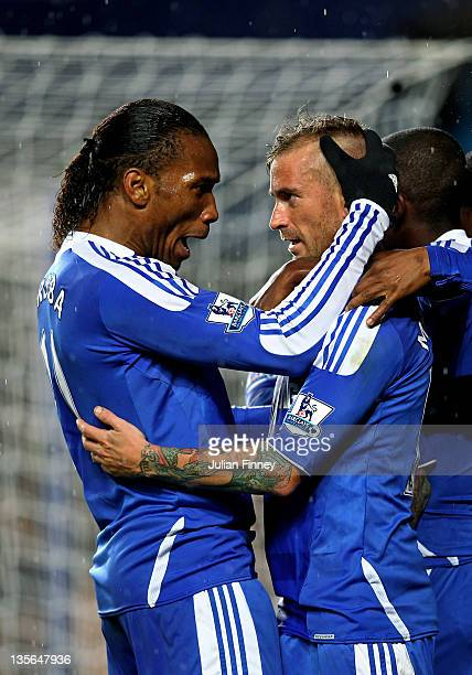 Raul Meireles of Chelsea is congratulated by teammate Didier Drogba after scoring a goal to level the scores at 11 during the Barclays Premier League...