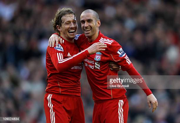 Raul Meireles of Liverpool celebrates scoring the opening goal with team mate Lucas during the Barclays Premier League match between Liverpool and...