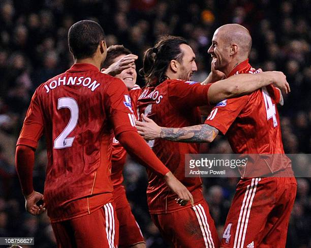 Raul Meireles of Liverpool is congratulated by teammates after scoring the opening goal the Barclays Premier League match between Liverpool and Stoke...
