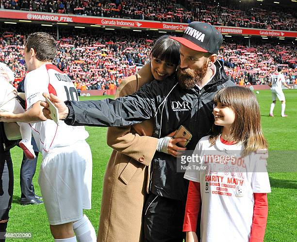 Raul Meireles takes a selfie with his family during the Liverpool All Star Charity Match at Anfield on March 29 2015 in Liverpool England