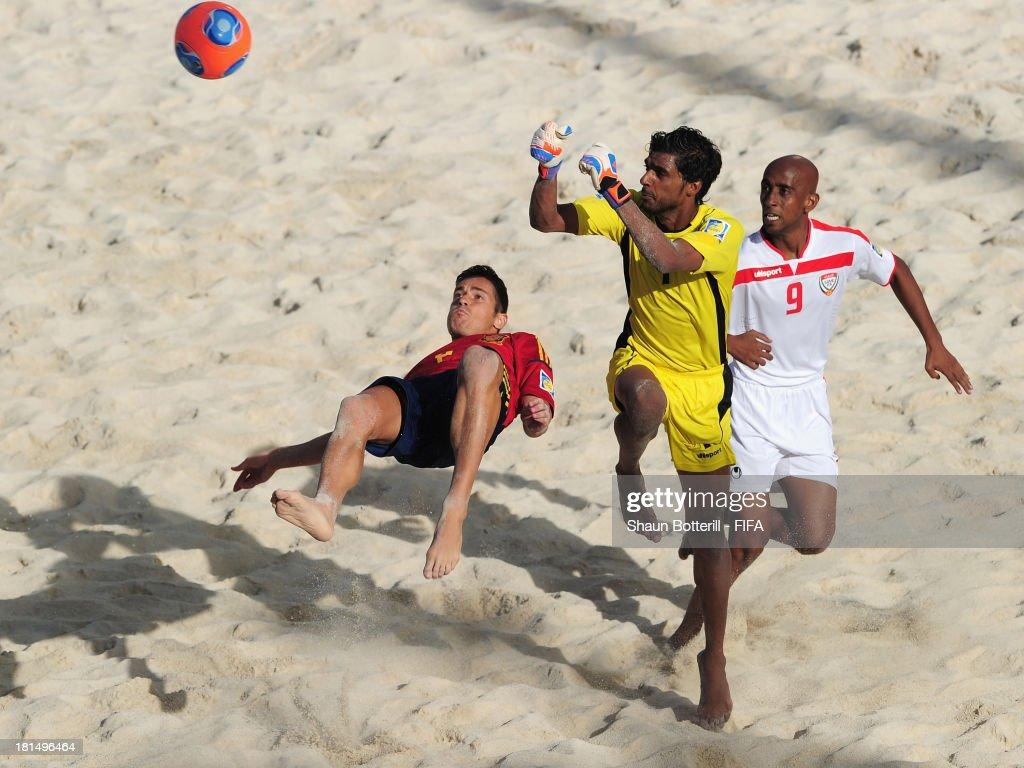 Raul Merida of Spain is challenged by Mohamed Aljasmi and Karim Albalooshi of United Arab Emirates during the FIFA Beach Soccer World Cup Tahiti 2013 Group A match between United Arab Emirates and Spain at the Tahua To'ata stadium on September 21, 2013 in Papeete, French Polynesia.