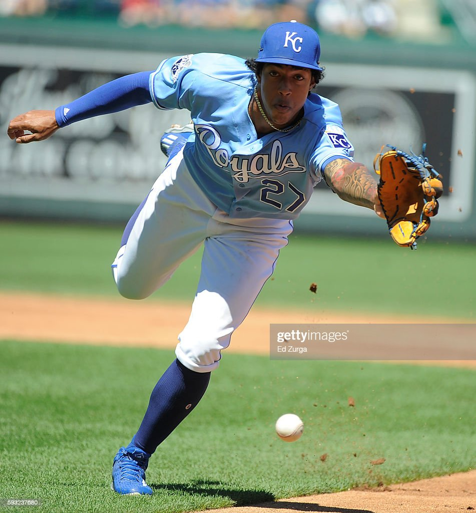 Raul Mondesi of the Kansas City Royals fields a ball hit by Jorge Polanco of the Minnesota Twins in the second inning at Kauffman Stadium on August...