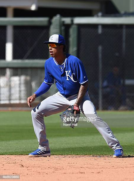 Raul Mondesi of the Kansas City Royals gets ready to make a play against the Texas Rangers on March 4 2015 at Surprise Stadium in Surprise Arizona