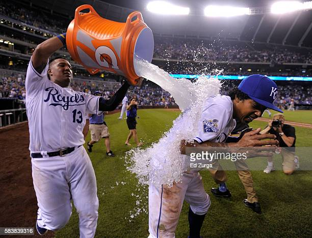 Raul Mondesi of the Kansas City Royals is doused with water by Salvador Perez as they celebrate a 75 win over the Los Angeles Angels of Anaheim at...