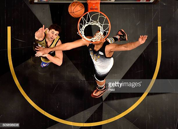 Raul Neto of the Utah Jazz and World team shoots against Jabari Parker of the Milwaukee Bucks and the United States team in the second half during...