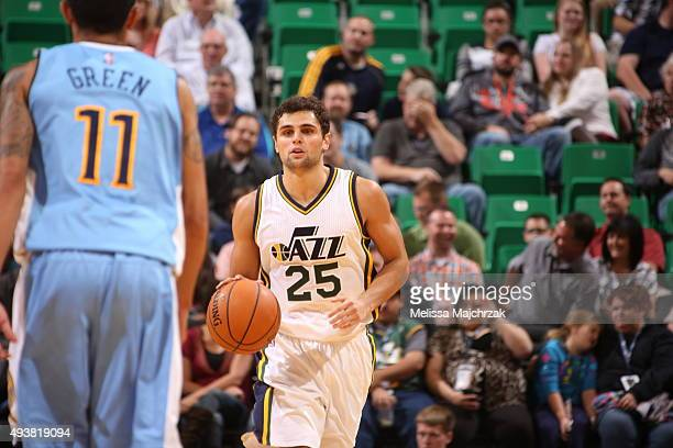 Raul Neto of the Utah Jazz brings the ball up court against the Denver Nuggets on October 22 2015 at EnergySolutions Arena in Salt Lake City Utah...