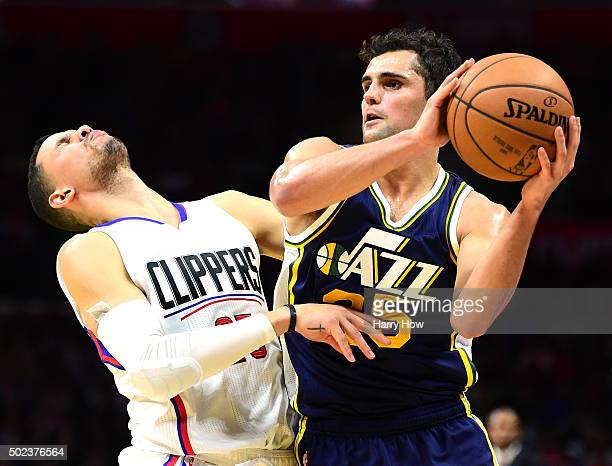 Raul Neto of the Utah Jazz bumps Austin Rivers of the Los Angeles Clippers at Staples Center on November 25 2015 in Los Angeles California