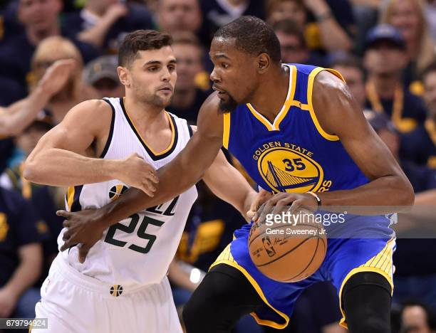 Raul Neto of the Utah Jazz defends against Kevin Durant of the Golden State Warriors in the first half in Game Three of the Western Conference...