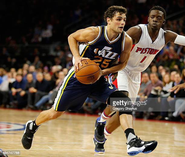 Raul Neto of the Utah Jazz drives around Reggie Jackson of the Detroit Pistons during the second half at the Palace of Auburn Hills on October 28...