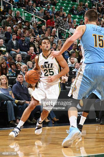 Raul Neto of the Utah Jazz drives to the basket against Nikola Jokic of the Denver Nuggets on October 22 2015 at EnergySolutions Arena in Salt Lake...