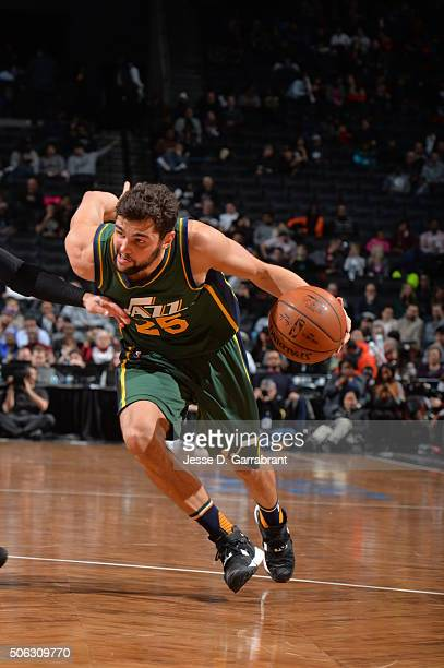 Raul Neto of the Utah Jazz drives to the basket against the Brooklyn Nets on January 22 2016 at Barclays Center in Brooklyn New York NOTE TO USER...