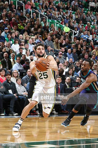 Raul Neto of the Utah Jazz drives to the basket against the Charlotte Hornets on January 27 2016 at vivintSmartHome Arena in Salt Lake City Utah NOTE...