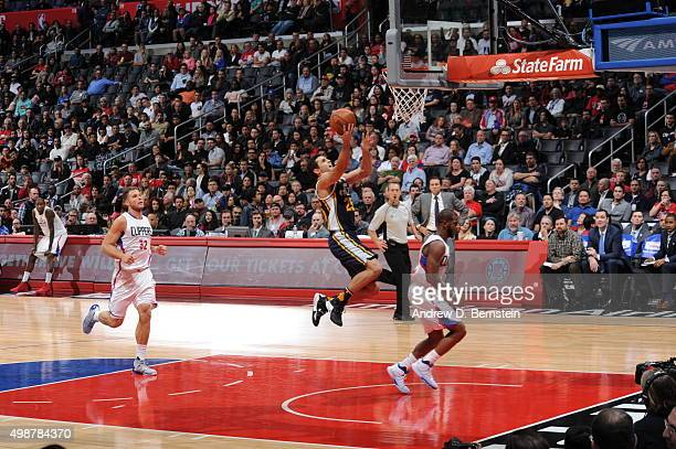 Raul Neto of the Utah Jazz goes to the basket against the Los Angeles Clippers on November 25 2015 at STAPLES Center in Los Angeles California NOTE...