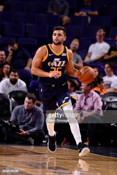 Raul Neto of the Utah Jazz handles the ball against the Phoenix Suns on October 9 2017 at Talking Stick Resort Arena in Phoenix Arizona NOTE TO USER...