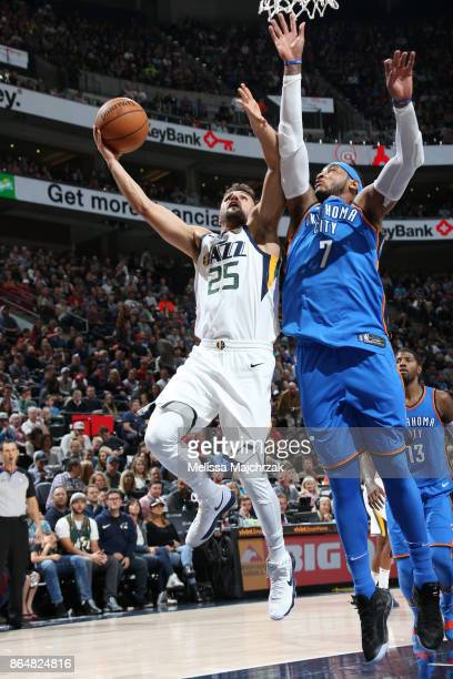 Raul Neto of the Utah Jazz shoots the ball against Carmelo Anthony of the Oklahoma City Thunder during the game on October 21 2017 at vivintSmartHome...