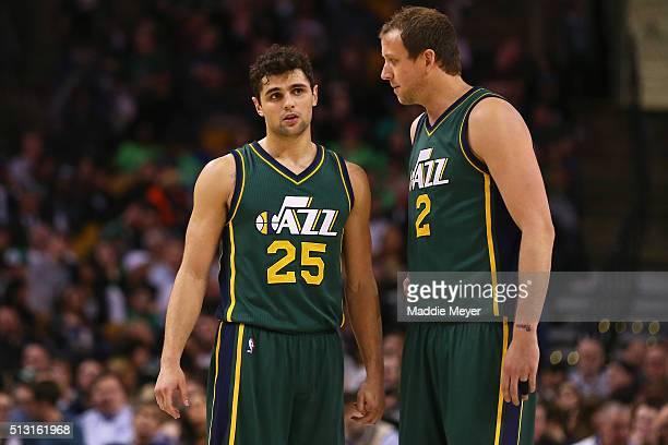 Raul Neto of the Utah Jazz talks with Joe Ingles during the third quarter against the Boston Celtics at TD Garden on February 29 2016 in Boston...