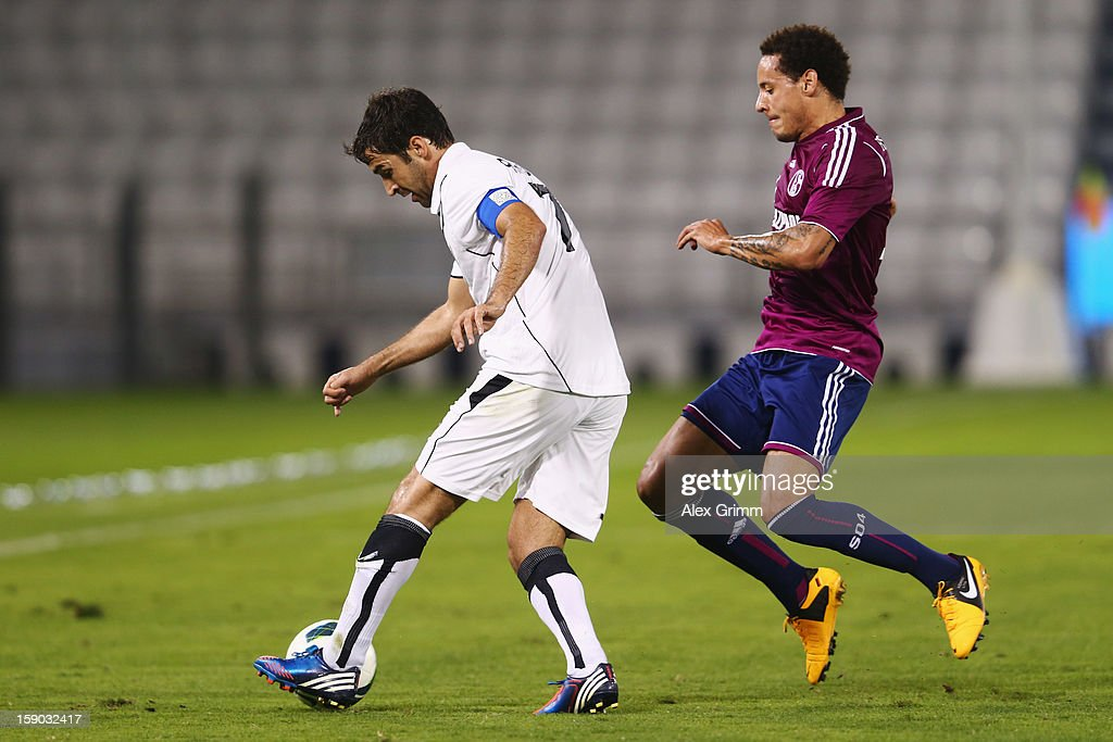Raul (L) of Al Sadd is challenged by <a gi-track='captionPersonalityLinkClicked' href=/galleries/search?phrase=Jermaine+Jones+-+Soccer+Player&family=editorial&specificpeople=12906336 ng-click='$event.stopPropagation()'>Jermaine Jones</a> of Schalke during the friendly match between Al-Sadd Sports Club and FC Schalke 04 at Jassim Bin Hamad Stadium on January 6, 2013 in Doha, Qatar.