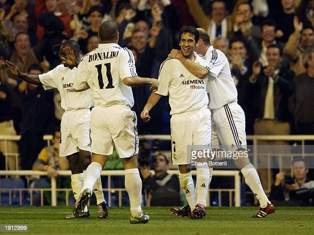 Raul of Real Madrid celebrates scoring the second goal with teammates Ronaldo and Zinedine Zidane during the UEFA Champions League quarterfinal first...