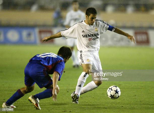 Raul of Real Madrid takes on Jo Kanazawa of FC Tokyo during the preseason friendly match between FC Tokyo and Real Madrid at the National Stadium...